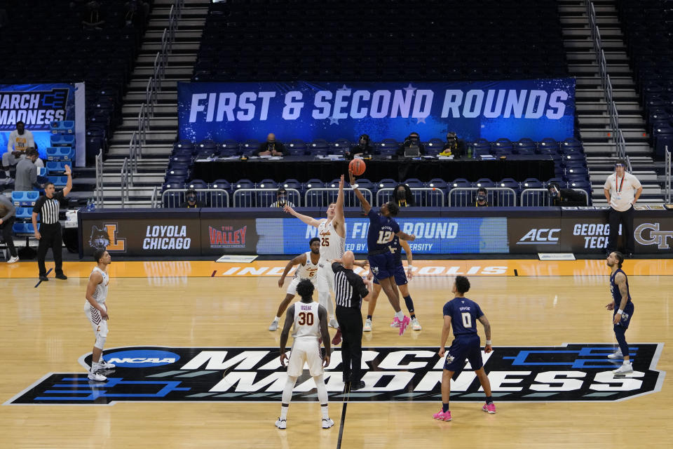 Georgia Tech tips off with Loyola Chicago at the start of a college basketball game in the first round of the NCAA tournament at Hinkle Fieldhouse, Indianapolis, Friday, March 19, 2021. (AP Photo/AJ Mast)