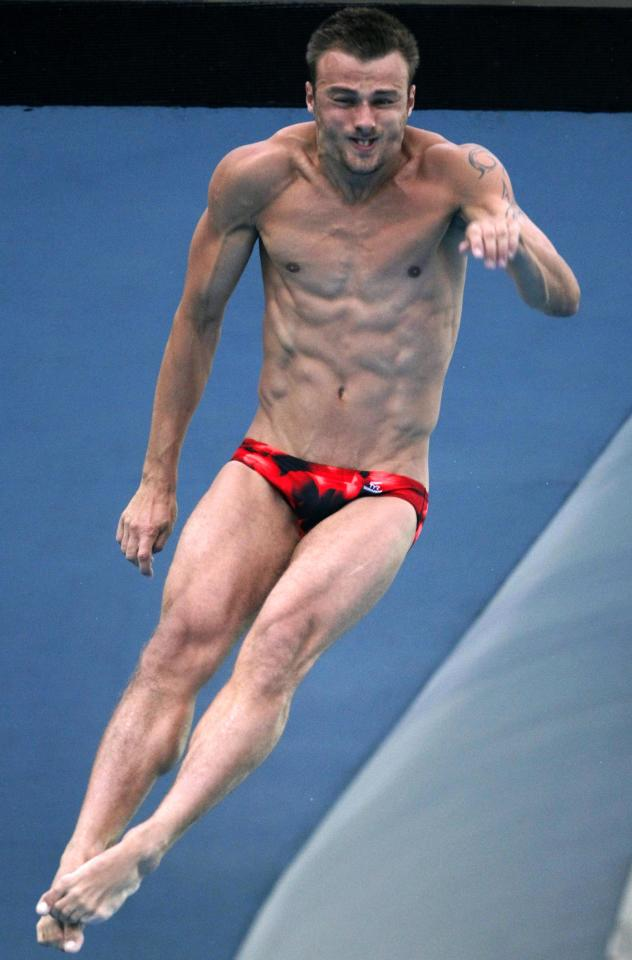Bronze medalist Germany's Sascha Klein competes in the finals of the men's 10m platform diving event at the FINA Swimming World Championships in Shanghai, China, Sunday, July 24, 2011. (AP Photo/Ng Han Guan)