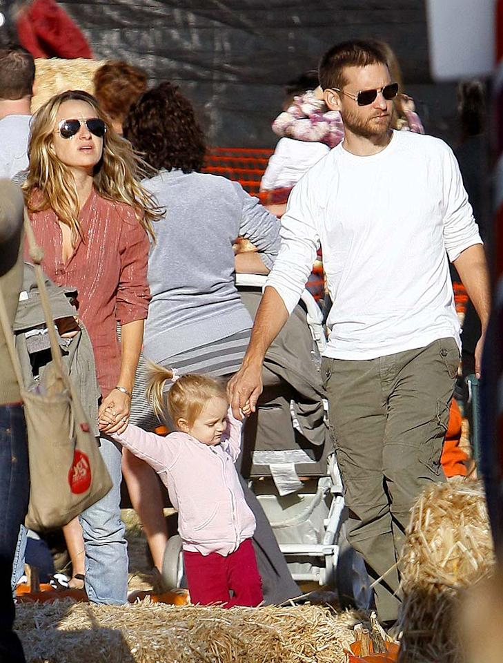 "Looks like Tobey Maguire (seen here with daughter Ruby Sweetheart and wife Jennifer Meyer) also prefers the scruffy look. <a href=""http://www.infdaily.com"" target=""new"">INFDaily.com</a> - October 11, 2008"