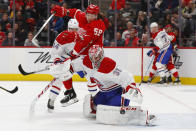 Montreal Canadiens goaltender Carey Price (31) deflects a shot as Detroit Red Wings left wing Tyler Bertuzzi (59) moves for the rebound during the second period of an NHL hockey game Tuesday, Feb. 18, 2020, in Detroit. (AP Photo/Paul Sancya)