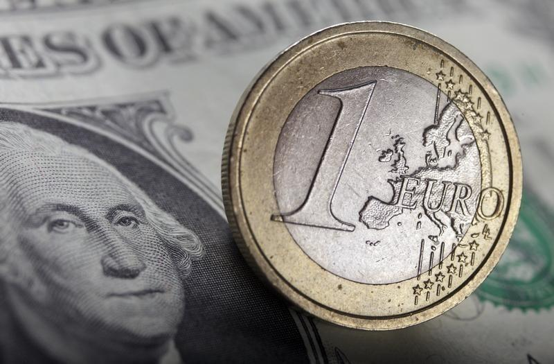 A picture illustration shows a U.S. dollar bank note and a one Euro coin