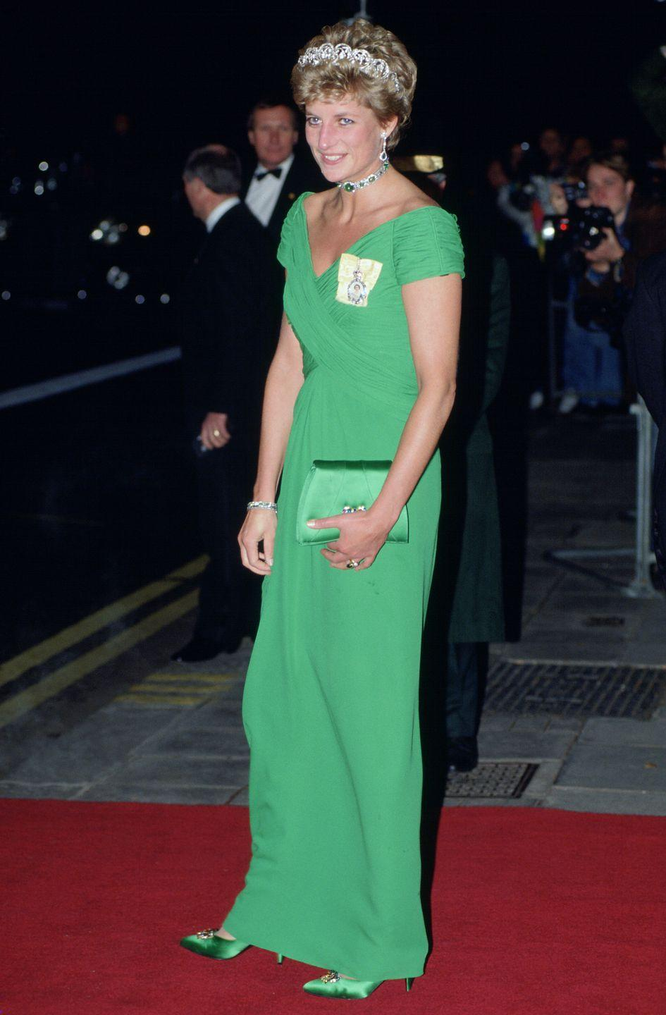 <p>The cap sleeve evening gown Princess Diana wore in 1993 was designed by one of her favorite designers, Catherine Walker. The bright green chiffon fabric and sleek column design is giving us serious mermaid tail vibes.</p>