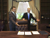 FILE — In this Oct. 23, 2003 file photo, Gov.-elect Arnold Schwarzenegger, left, and Gov. Gray Davis joke with each other as Davis shows Schwarzenegger the governor's private office at the Capitol in Sacramento, Calif. The two met for the first time since the voters elected Schwarzenegger to replace Gov. Gray Davis in the historic 2003 recall election. Today's California electorate is less Republican and more Asian and Latino than it was 18 years ago, trends that favor Newsom. (AP Photo/Rich Pedroncelli, File)