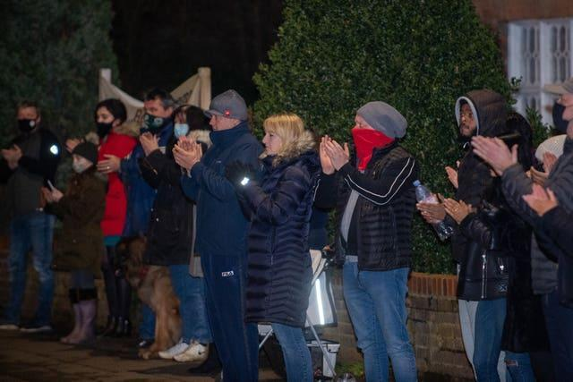 Residents from the village of Marston Moretaine join in with a nationwide clap in honour of Captain Sir Tom Moore, the 100-year-old charity fundraiser who died on Tuesday after testing positive for Covid-19