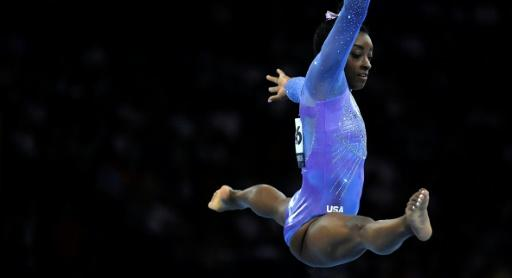USA's Simone Biles on her way to winning the floor final on Sunday in Stuttgart, earning the 25th medal of her career at world gymnastics championships