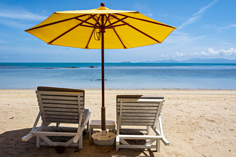Chairs and umbrella on the beach for relaxing and holiday.