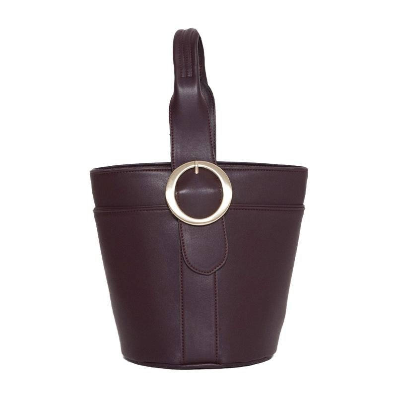 """<a rel=""""nofollow"""" href=""""https://thefrankieshop.com/collections/accessories/products/dark-burgundy-bucket-bag"""">Bucket Bag, The Frankie Shop, $105</a>"""