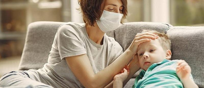 mother-checking-his-son-if-he-has-fever-3985214.jpg