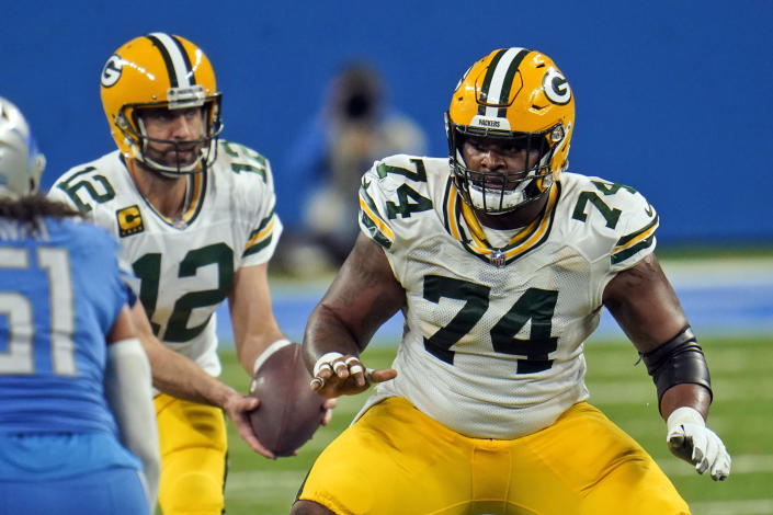 FILE - In this Dec. 13, 2020, file photo, Green Bay Packers offensive guard Elgton Jenkins looks to block during the second half of an NFL football game against the Detroit Lions in Detroit. Jenkins has spent his NFL career demonstrating he can thrive at just about every spot on the offensive line at one time or another. Now the Pro Bowl left guard looks forward to his biggest test yet as he fills in for injured All-Pro selection David Bakhtiari at left tackle and leads a Packers line that likely will include two rookie starters. (AP Photo/Paul Sancya, File)