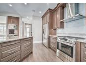 <p><span>616 3 Avenue Northwest, Calgary, Alta.</span><br> The kitchen features cherry wood cabinets, stainless steel appliances and granite countertops.<br> (Photo: Zoocasa) </p>