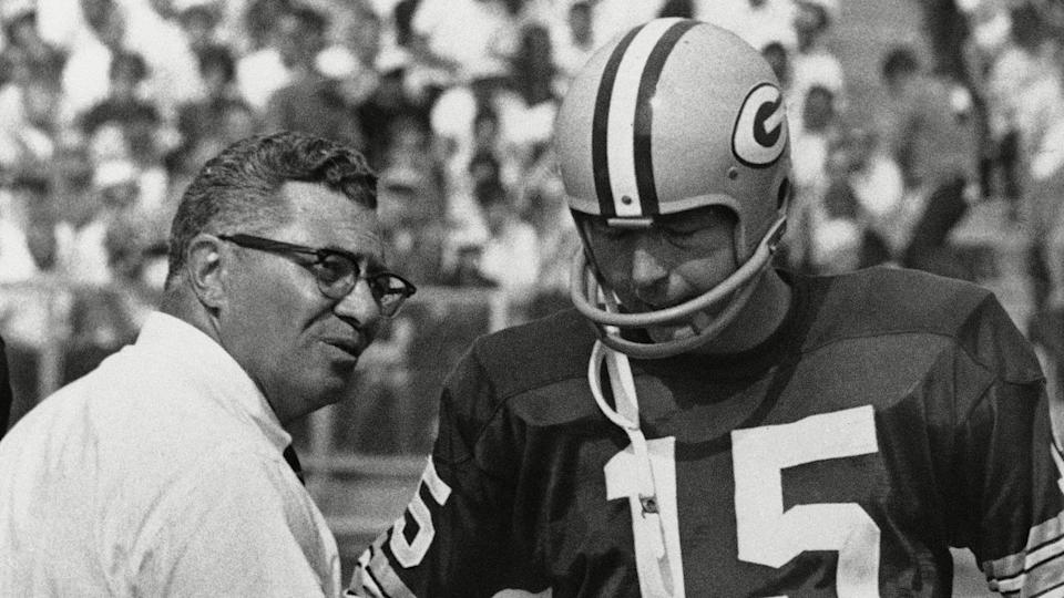 Mandatory Credit: Photo by Anonymous/AP/Shutterstock (6643320a)Green Bay Packer coach Vince Lombardi, center, speaks with quarterback Bart Starr (15) and Zeke Bratkowski, left, as the Packers trailed the Detroit Lions at Green Bay, .