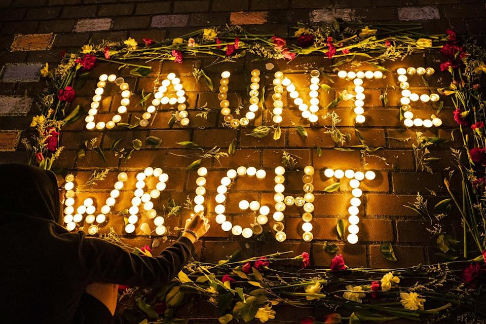SEATTLE, WA - APRIL 12: A display of candles and flowers spells the name of Daunte Wright at a protest over his death on April 12, 2021 in Seattle, Washington. Wright, a Black man whose car was stopped in Brooklyn Center, Minnesota on Sunday reportedly for an expired registration, and not far from where George Floyd was killed during an arrest in Minneapolis last May, was shot and killed by an officer who police say mistook her service revolver for a Taser.  (Photo by David Ryder/Getty Images)