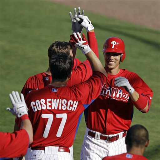 Philadelphia Phillies players, including Tuffy Gosewisch (77), greet Luis Montanez after Montanez hit a game-winning, tenth-inning solo home run off Pittsburgh Pirates reliever Michael Dubee in their spring training baseball game at Brighthouse Field in Clearwater, Fla., Thursday, March 8, 2012. The Phillies won 5-4. (AP Photo/Kathy Willens)