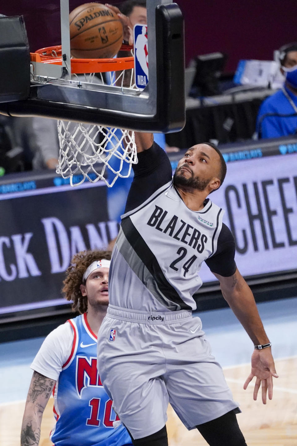 Portland Trail Blazers forward Norman Powell (24) dunks during the second half of an NBA basketball game against the Brooklyn Nets, Friday, April 30, 2021, in New York. (AP Photo/Mary Altaffer)