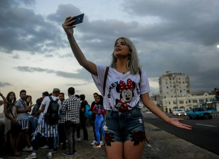 A Cuban youtuber records her youtube program at Havana's seaside Malecon