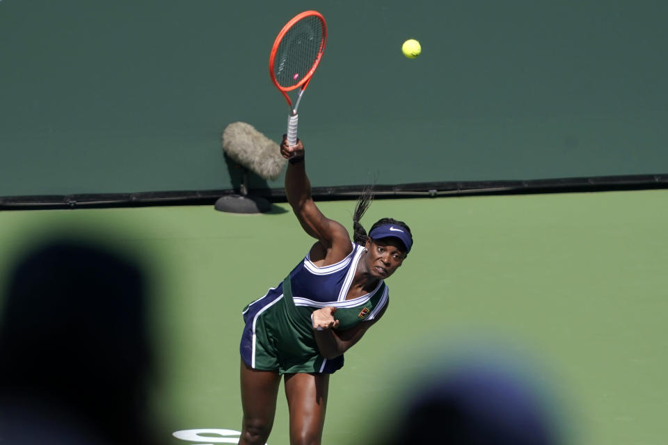 Fans look on as Sloane Stephens, of the United States, serves to Heather Watson, of Britain, at the BNP Paribas Open tennis tournament Wednesday, Oct. 6, 2021, in Indian Wells, Calif. (AP Photo/Mark J. Terrill)