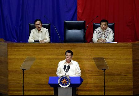 Philippine President Rodrigo Duterte delivers his State of the Nation address at the House of Representatives in Quezon city, Metro Manila, in Philippines July 23, 2018. At the upper podium (L-R) Senate President Vicente Sotto and Speaker of the House Pantaleon Alvarez.  REUTERS/Czar Dancel