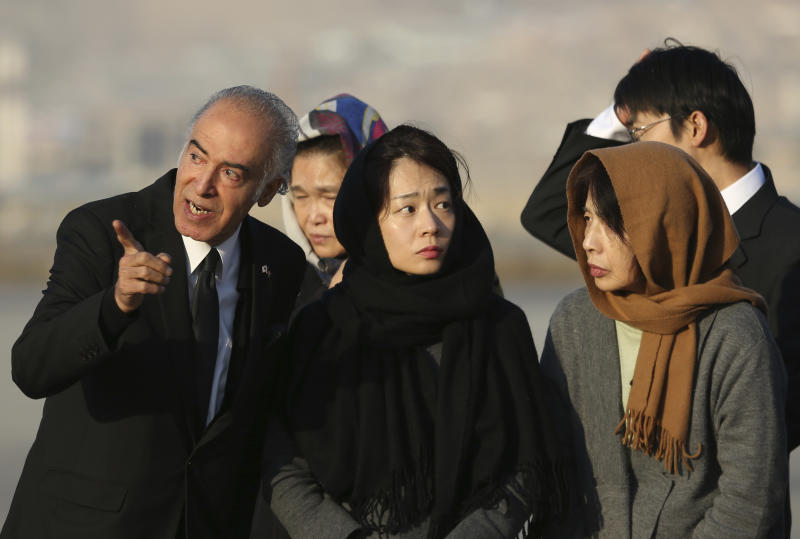 From right, Naoko Nakamura, wife, and, Akiko Nakamura, daughter of slain Japanese physician Tetsu Nakamura stand during a ceremony before transporting his body to his homeland, at the Hamid Karzai International Airport in Kabul, Afghanistan, Saturday, Dec. 7, 2019. Nakamura was killed earlier this week in a roadside shooting in eastern Afghanistan. (AP Photo/Rahmat Gul)