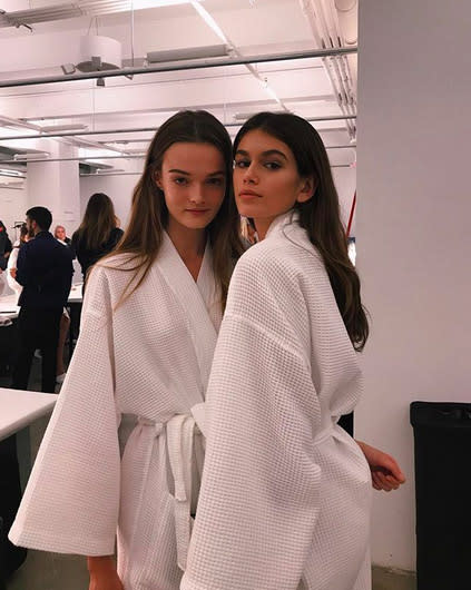 "<p>Obviously, robes are an NYFW staple. (All those outfit changes!) Here she's donning another one as she hangs with fellow model Lulu preshow. ""another bathrobe @calvinklein,"" she wrote. Sorry, Kaia — that not just another bathrobe. (Photo: <a href=""https://www.instagram.com/p/BYwa9nyhPAx/?hl=en&taken-by=kaiagerber"" rel=""nofollow noopener"" target=""_blank"" data-ylk=""slk:Kaia Gerber via Instagram"" class=""link rapid-noclick-resp"">Kaia Gerber via Instagram</a>) </p>"