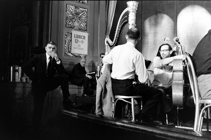 """Clark Gable, known for years as """"The King of Hollywood,"""" chats with the band during a break in rehearsals, 1958. (Leonard McCombe—TIME & LIFE Pictures/Getty Images) <br> <br> <a href=""""http://life.time.com/culture/oscars-rare-photos-from-academy-award-rehearsals-1958/#1"""" rel=""""nofollow noopener"""" target=""""_blank"""" data-ylk=""""slk:Click here to see the full collection at LIFE.com"""" class=""""link rapid-noclick-resp"""">Click here to see the full collection at LIFE.com</a>"""