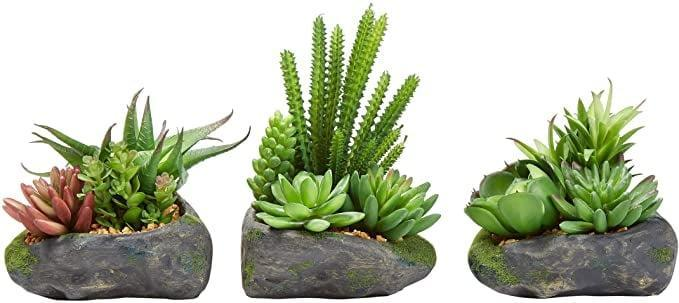 <p>Bring the outdoors inside with the <span>Pure Garden Artificial Succulent Plant Arrangements in Faux Stone Pots 3 Piece Set</span> ($33).</p>