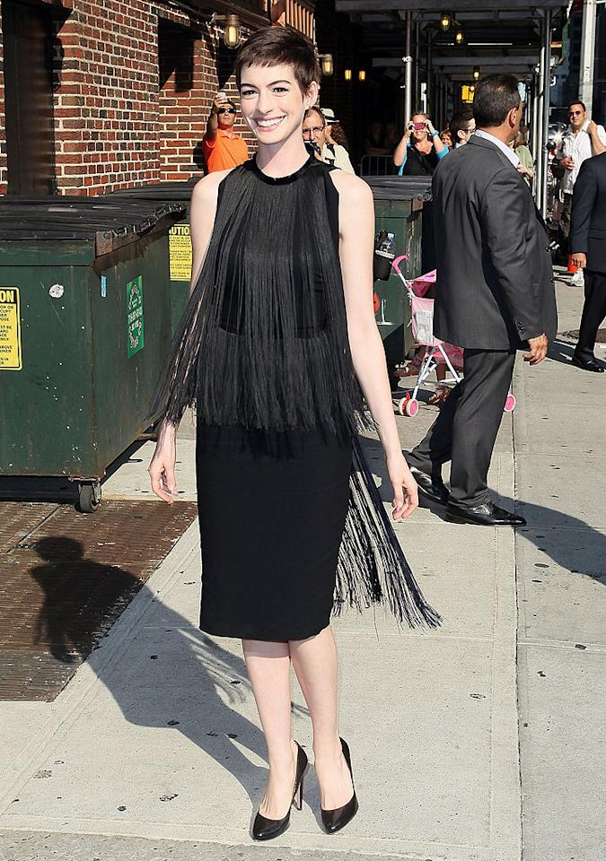 """Also spotted in an eyesore-inducing black outfit was <a target=""""_blank"""" href=""""http://movies.yahoo.com/movie/the-dark-knight-rises/"""">""""The Dark Knight Rises""""</a> actress, Anne Hathaway, who promoted the soon-to-be-blockbuster on """"Late Show With David Letterman"""" in this fringe-adorned Stella McCartney flop. Adding insult to injury was her unfortunate pixie cut. (7/11/2012)<br><br><a target=""""_blank"""" href=""""http://twitter.com/YahooOmg"""">Follow omg! on Twitter!</a>"""