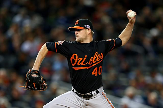 NEW YORK, NY - OCTOBER 12: Troy Patton #40 of the Baltimore Orioles pitches against the New York Yankees during Game Five of the American League Division Series at Yankee Stadium on October 12, 2012 in New York, New York. (Photo by Elsa/Getty Images)