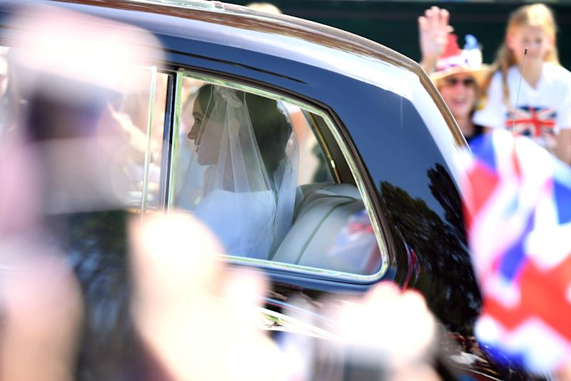 WINDSOR, ENGLAND - MAY 19: Meghan Markle with arrives at Windsor Castle ahead of her wedding to Prince Harry on May 19, 2018 in Windsor, England. Prince Henry Charles Albert David of Wales marries Ms. Meghan Markle in a service at St George's Chapel inside the grounds of Windsor Castle. Among the guests were 2200 members of the public, the royal family and Ms. Markle's Mother Doria Ragland. (Photo by Chris J Ratcliffe/Getty Images)