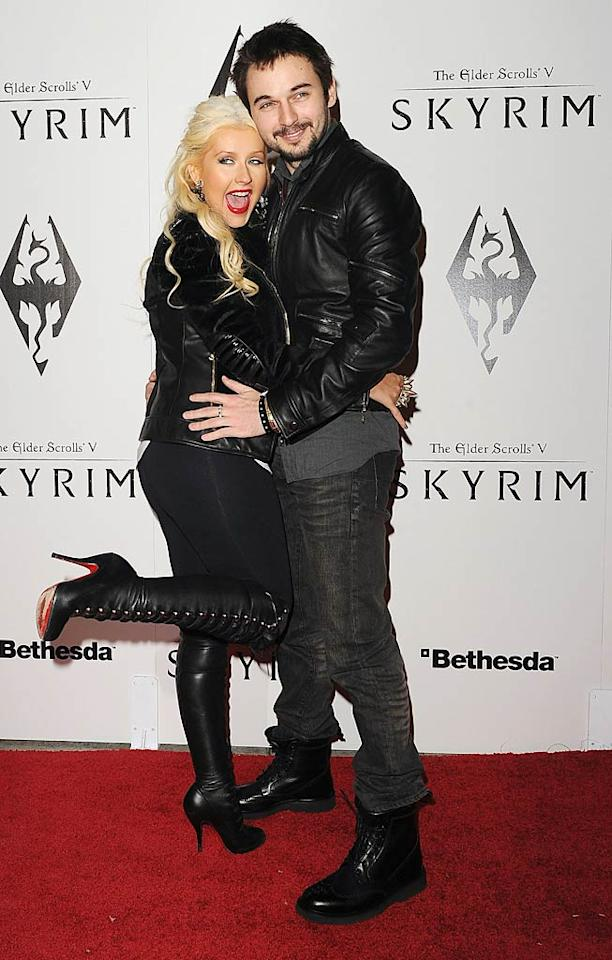 Songstress Christina Aguilera and her boy toy Matt Rutler were among the celebs at the launch party for the video game The Elder Scrolls V: Skyrim at the Belasco Theater in L.A. on Tuesday. Apparently, Xtina, clad in an Alexander McQueen tank, a Versace jacket, and Christian Louboutin boots, couldn't keep their hands off her man! The two were photographed kissing and hugging on the red carpet. (11/8/2011)