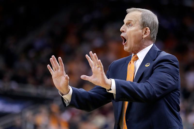 Tennessee head coach Rick Barnes shouts instructions during the second half of a men's NCAA Tournament college basketball South Regional semifinal game against Purdue Thursday, March 28, 2019, in Louisville, Ky. (AP Photo/Michael Conroy)