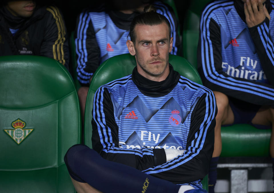 SEVILLE, SPAIN - MARCH 08: Gareth Bale of Real Madrid sits on the substitutes bench prior to the Liga match between Real Betis Balompie and Real Madrid CF at Estadio Benito Villamarin on March 08, 2020 in Seville, Spain. (Photo by Manuel Queimadelos/Quality Sport Images/Getty Images)