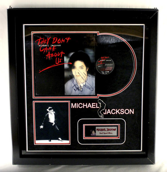 "FILE - This undated file photo provided by Texas-based Gaston & Sheehan Auctioneers, Inc. shows a Michael Jackson autographed record album titled ""They Don't Care About Us"" that once belonged to former Illinois Congressman Jesse Jackson Jr. The U.S. Marshals service said Friday, Sept. 20, 2013, that it's canceling a high-profile auction of clothing and memorabilia belonging to the convicted former congressman and his wife because of questions about the authenticity of some items. The U.S. Marshals Service began the auction earlier this week to recoup part of the $750,000 in campaign funds the former congressman and his wife illegally spent on memorabilia, furs, vacations and other personal items. (AP Photo/Courtesy Gaston & Sheehan Auctioneers, Inc., File)"