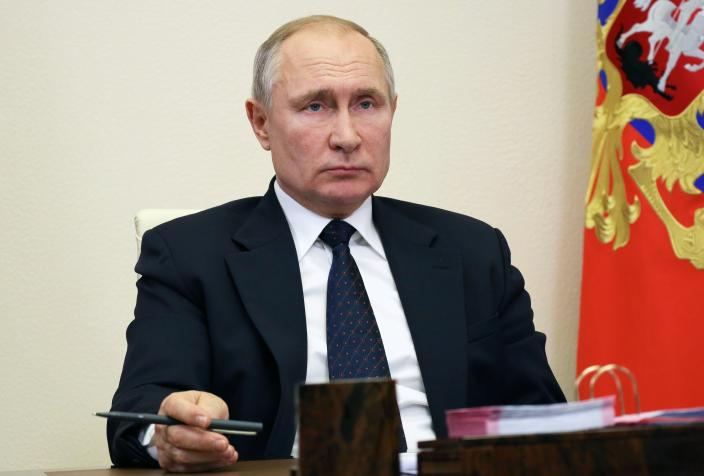 Russian President Vladimir Putin attends a meeting via video conference at his residence.