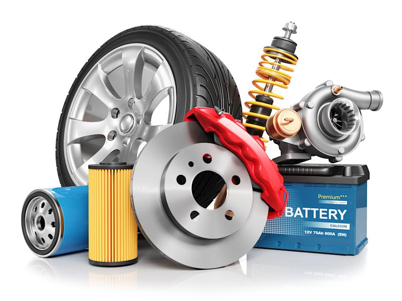 A collection of auto parts, including a tire, a battery, etc.
