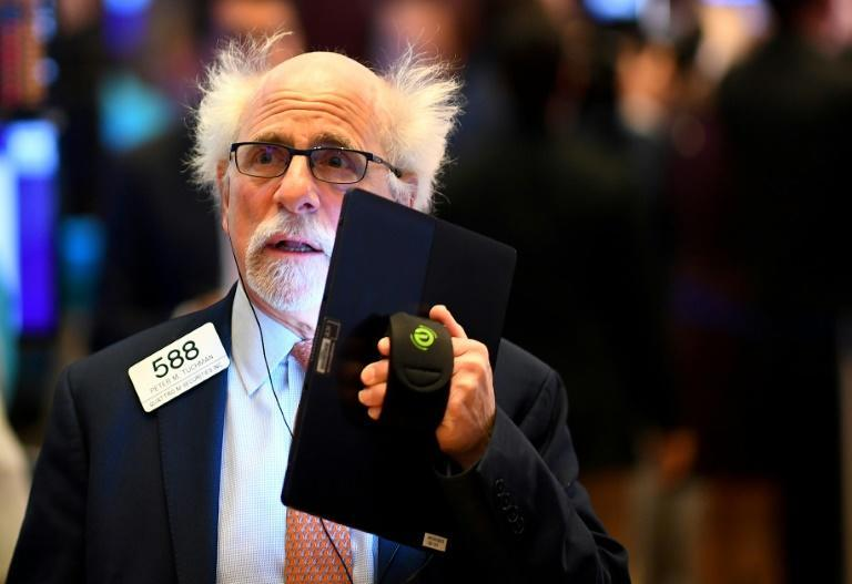 Wall Street was cheered by news that the G7 would hold talks amid the coronavirus outbreak, sending the Dow up over 3.0 percent (AFP Photo/Johannes EISELE)