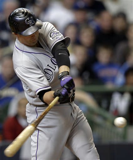 Colorado Rockies' Michael Cuddyer hits a two-run double during the eighth inning of a baseball game against the Milwaukee Brewers, Sunday, April 22, 2012, in Milwaukee. (AP Photo/Morry Gash)