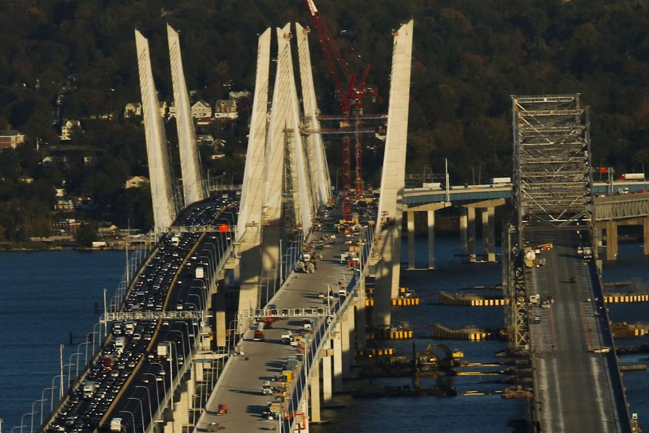 <p>Maximum passenger-car fee: $13.75</p><p>Type: Interstate Bridge<br>Between: Nyack and Tarrytown, New York<br>Length: 3.7 miles<br><br>Fun fact: The original Tappan Zee span was closed in 2017 and has since been replaced by a parallel span dubbed the Governor Mario M. Cuomo Bridge. Both are pictured here, with the new bridge (left)  under construction alongside the old Tappan Zee (right).</p>