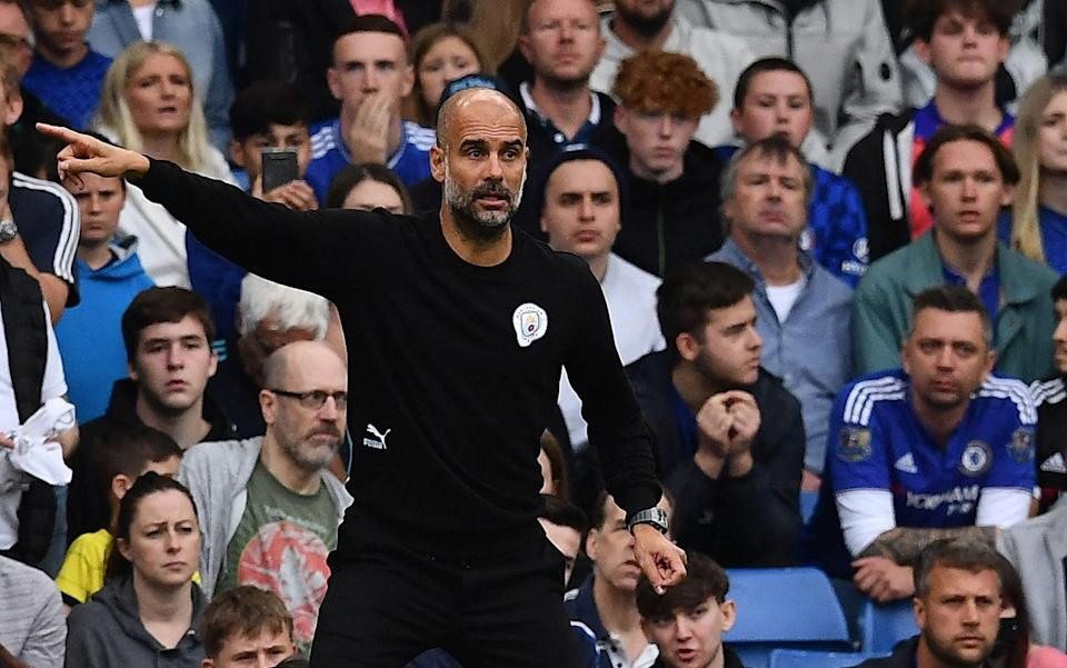 Manchester City's Spanish manager Pep Guardiola gestues during the English Premier League football match between Chelsea and Manchester City at Stamford Bridge in London on September 25, 2021. - AFP