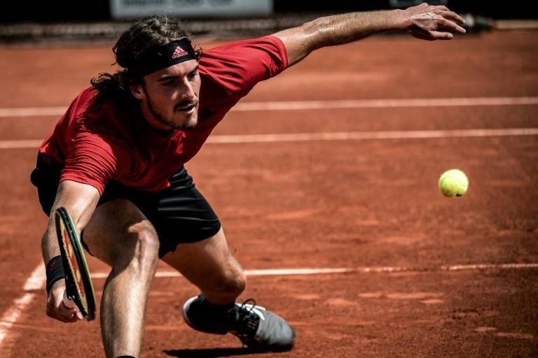 Greece's Stefanos Tsitsipas, promoted to third seed in the absence of Rafael Nadal, has a tough opener against 56th-ranked Frances Tiafoe of the United States