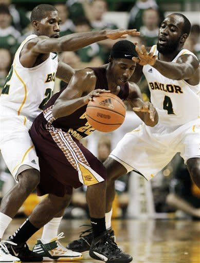 Baylor guard A.J. Walton, left, and Quincy Acy (4) defend as Bethune-Cookman guard Ricky Johnson drives upcourt in the second half of an NCAA college basketball game, Wednesday, Dec. 14, 2011, in Waco, Texas. Baylor won 69-42. (AP Photo/Tony Gutierrez)