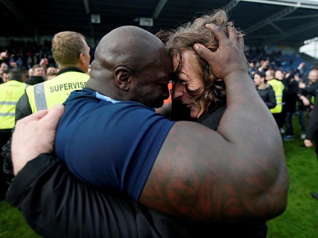 """Soccer Football - League Two - Chesterfield v Wycombe Wanderers - Proact Stadium, Chesterfield, Britain - April 28, 2018 Wycombe Wanderers Manager Gareth Ainsworth celebrates with Adebayo Akinfenwa after winning promotion Action Images/Paul Childs EDITORIAL USE ONLY. No use with unauthorized audio, video, data, fixture lists, club/league logos or """"live"""" services. Online in-match use limited to 75 images, no video emulation. No use in betting, games or single club/league/player publications. Please contact your account representative for further details."""