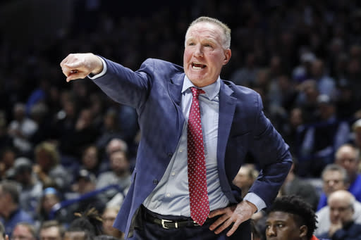 St. John's head coach Chris Mullin directs his players from the bench in the first half of an NCAA college basketball game against Xavier, Saturday, March 9, 2019, in Cincinnati. (AP Photo/John Minchillo)