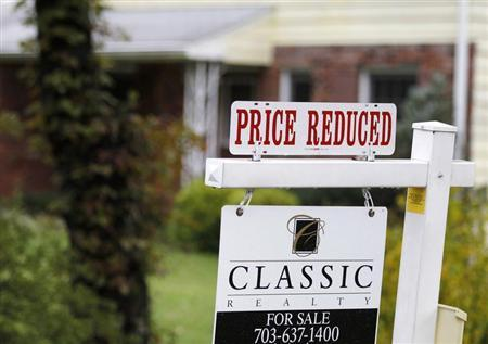 "A ""Price Reduced"" sign is displayed on a home for sale in northern Virginia suburb of Vienna"