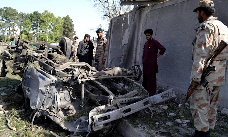 Pakistani soldiers examine the site of bombing in Quetta, Pakistan on Monday, May 13, 2013. An explosive-laden vehicle rammed into the convoy of provincial police chief on Monday killing many and leaving dozens wounded, police said. (AP Photo/Arshad Butt)