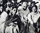 Photograph of Mahatma Gandhi being supported by his granddaughters. (Photo by: Universal History Archive/Universal Images Group via Getty Images)