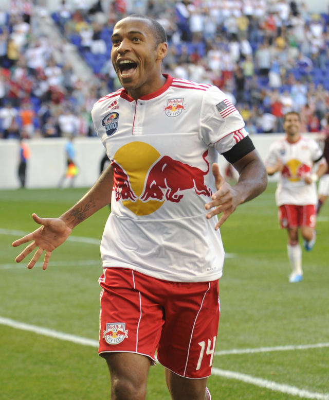 FILE - In this Sept. 11, 2010, file photo, New York Red Bulls' Thierry Henry celebrates his goal during the first half of an MLS soccer game against the Colorado Rapids, in Harrison, N.J. Brad Friedel, Carlos Bocanegra and Thierry Henry are among first-year eligible nominated for the National Soccer Hall of Fames class of 2018. (AP Photo/Bill Kostroun, File)