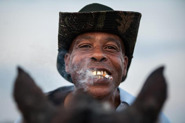 <p>James, a smoking Delta cowboy with a golden grill, poses for a portrait in Bolivar County, Miss., November 2017. (Photograph by Rory Doyle) </p>