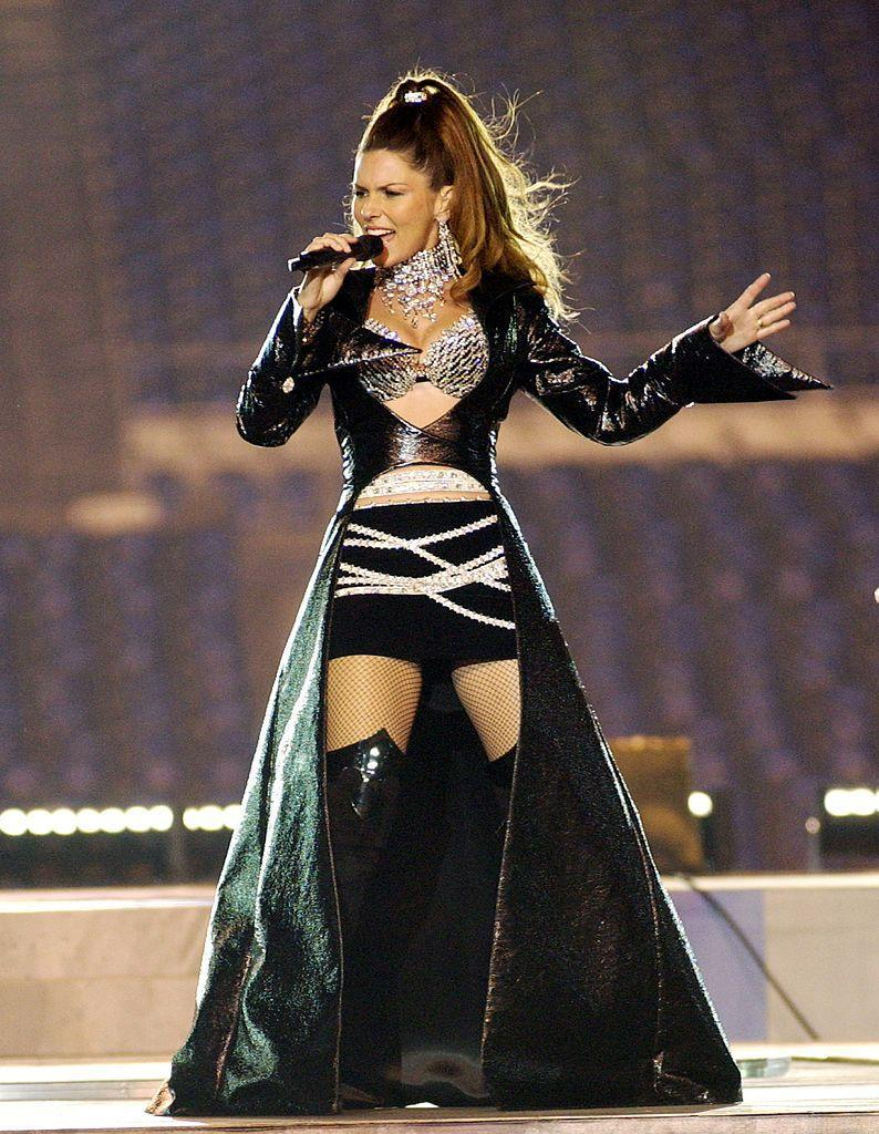 """<p>Canadian singer Shania Twain kicked off the halftime show in 2003 in knee-high boots, a bedazzled bra and cut-out Matrix-style coat.</p><p><a class=""""link rapid-noclick-resp"""" href=""""https://www.youtube.com/watch?v=RfHcx8E4htM&ab_channel=UNIVERSOBITCOIN"""" rel=""""nofollow noopener"""" target=""""_blank"""" data-ylk=""""slk:WATCH NOW"""">WATCH NOW</a></p>"""
