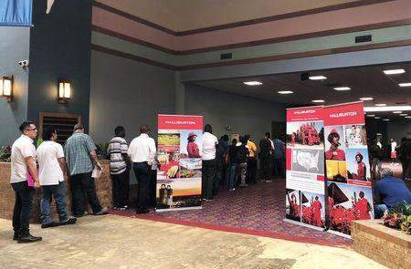 Job seekers line up at a job fair of an oil services giant Halliburton at the MCM Grande Fundome hotel in Odessa, Texas, U.S., July 19, 2018. Picture taken on July 19, 2018. REUTERS/Liz Hampton