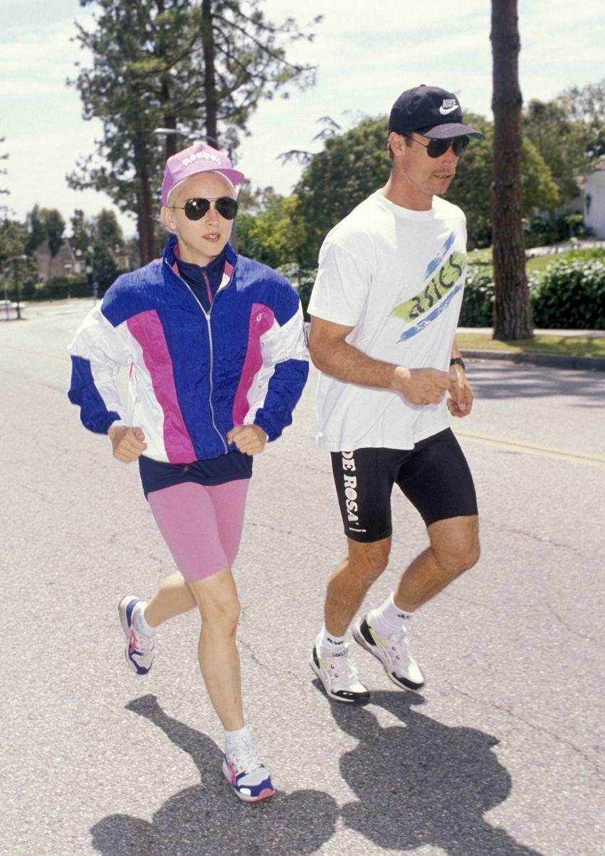 WHO: Madonna. Style Notes: Between the baseball hat, the windbreaker, and the bright jewel tones, we don't know what's more '80s about Madonna's jogging outfit.